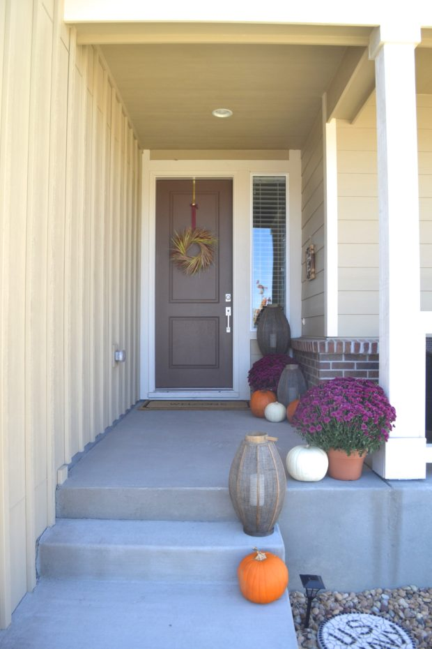 Click here to take a tour of a purple and orange fall front porch. Welcome!