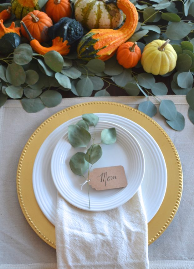 Thankgsiving tablescape with eucalyptus leaves, eucalyptus and pumpkin thanksgiving centerpiece, thanksgiving pumpkin table centerpiece